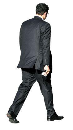 Man in suit walking outside Alex Proimos/CC-Attribution