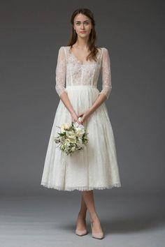 White A Line Tea Length V Neck 3/4 Sleeve Lace Wedding Dress,Beach Wedding Dress W231 https://www.ombreprom.com/products/white-a-line-tea-length-v-neck-3-4-sleeve-lace-wedding-dress-beach-wedding-dress-w231