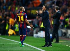Luis Enrique manager of Barcelona in discussion with Javier Mascherano of Barcelona during the UEFA Champions League Quarter Final second leg match between FC Barcelona and Paris Saint-Germain at Camp Nou on April 21, 2015 in Barcelona, Catalonia.