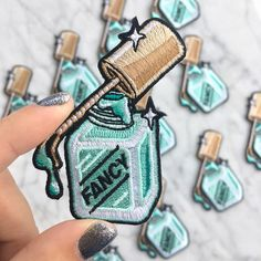 "Description: Fancy ladies!!! This is THE patch for us all. Fun minty - aqua polish is sparkling & dripping down the bottle declaring FANCY. Because seriously what else? Wildflower + Co. patches are the perfect instant update! Patches feature an iron-on backing & ship with instructions. ✳ Measures approx. 2 1/2"" tall x 2"" wide ✳ Designed by & exclusive to Wildflower + Co. ✳ Iron on bac"