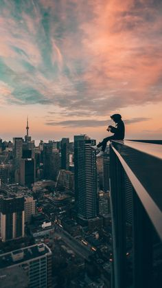 phone wallpaper for men A Man Sitting on Top of a Building Phone Wallpaper For Men, City Wallpaper, Anime Scenery Wallpaper, Dark Wallpaper, Wallpaper Backgrounds, Alone Photography, Nature Photography, Boy Photography Poses, Urban Photography