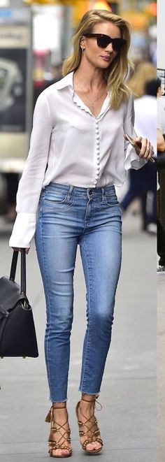 #spring #outfits woman wearing white button-up shirt and blue jeans carrying black bag. Pic by @city_streetstyles
