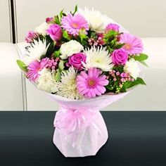 An attractive pink and white aqua pack bouquet. Pink Germinis, Roses, Bouvardia and Alstroemeria sit perfectly amongst white Chrysanthemums and Carnations.