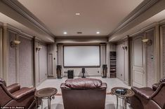 Chill-out zone: There's also a home movie theater with brown-leather recliner seats...