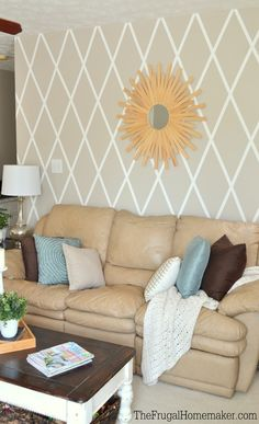 All you need to give your home a completely new look is a fresh coat of paint. Christina from The Frugal Homemaker added a stylish greige accent wall to her living room in just a few easy steps. Use painter's tape to create a modern diamond pattern on your walls. Then, paint over the tape using the neutral hues of Wheat Bread to create your DIY accent wall. It's as easy as that!
