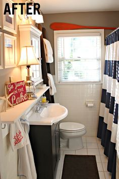 red Bathroom Decor Cute bathroom redo using West Elm shower curtain. I especially like the shelf above the sink, with the towel hooks at the end. And, the ladder as a towel rack, stacked on the toilet. Casa Hotel, Bathroom Renos, Bathroom Ideas, Bathroom Things, Design Bathroom, Bathroom Layout, Bathroom Storage, Bathroom Cabinets, Bath Ideas