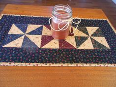 Country Colors Quilted Table Runner/ Scrap Quilt Pinwheel Pattern Burgundy, Navy, Green and Black by RubysQuiltShop on Etsy