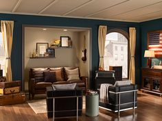 Deep colors are great to create an urban yet modern space. We love pairing a color like this dark turquoise with browns and neutrals to create a eclectic feeling.