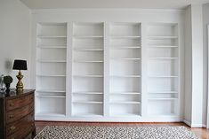 Turn inexpensive IKEA Billy Bookcases into beatiful custom looking shelves with a bit of trim and molding. Looks like custom built-ins for a fraction of the price.