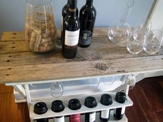 If you have read my Gallery Wall post (read it here) you know we had an old rotting dock that was scary to walk on, but the wood was just perfect for all sorts of fun projects! Like this wine rack I redid using some of that lovely wood. I especially love the old nail …