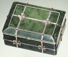 Box in the form of a banded trunk, House of Carl Fabergé, 1839-1908. Nephrite,gold,enamel,diamonds.