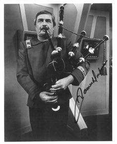 A signed photo of James Doohan as Scotty playing the bagpipes Star Trek II: The Wrath of Kahn .