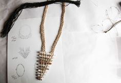 Original drawing of one of Sekimachi's jewelry pieces and the finished necklace