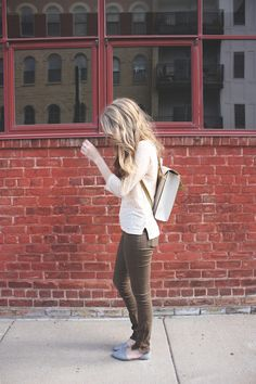 I love so many things about this photo. her hair, her shoes, her top, that wall, those windows. ok i'm done.