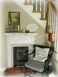Homemade faux fireplace, check seat cushion and made feedsack pillow