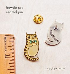 this little brass cat pin is now available the boygirlparty shop! – shop.boygirlparty.com