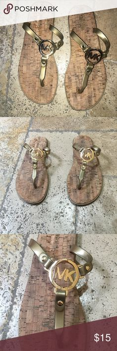 Michael Kors Flip Flops Michael Kors flip flops. Used, still in great condition. Selling because they are a 9 and I usually wear a 10, so they are a little short on my heel. These are beautiful flip flops! Michael Kors Shoes Sandals