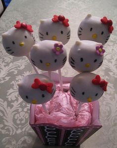 Hello Kitty cupcakes on a stick! USE WHITECHOCOLATE MORSELS BEFORE DIPPING FOR THE POINTY EAR LOOK