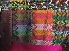 The Malong - Traditionally worn either as a dress or as a skirt by people in the southern and southwestern regions of the Philippines, the Malong boasts of intricate workmanship, bright colours and at times, depending on the material, may indicate a person's economic status, clan, village and ethnic origins. Sharing similarities to the Indonesian sarong the malong may be handwoven or machine-printed and is also often used for decorative purposes as wall art and as upholstery.