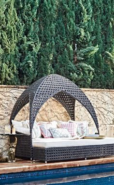 Curl up comfortably and escape to the inner sanctum of our Bali Daybed. Cooling breezes flit in and out of the uniquely woven hideaway with cathedral-domed canopy.   Frontgate: Live Beautifully Outdoors