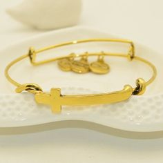 Looking for a nice gift idea? Try these Cross Expandable Wire Bangle Bracelet. This gold colored bangle bracelet is perfect as a religious gift. This expandable bracelet is great for young adults, adults and women who likes to wear jewelry. Awesome for any occasions.