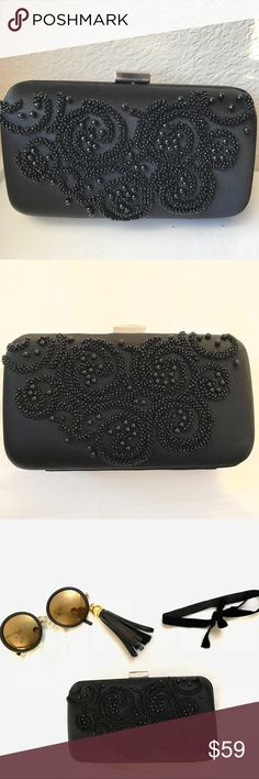 Beaded Embroidered Black Ann Taylor Satin Clutch Gorgeous Ann Taylor Clutch in impeccable Classic taste. Goes with every outfit. Excellent Condition. Silver clasp on top. Can carry everything you need on an evening out/ brunch with friends Ann Taylor Bags Clutches & Wristlets