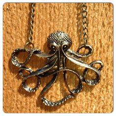 """Bronze color. 26"""" chain"""
