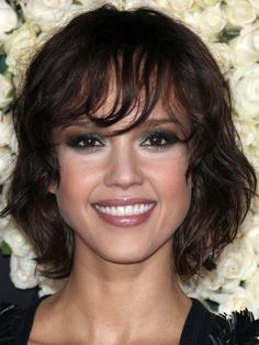 Jessica Alba thin, curly bangs: http://beautyeditor.ca/2014/07/30/best-bangs-for-oval-face/