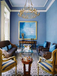 Living Room Designs: Stately Seating    Intricate mosaic tiling combined with carved wood furniture and silk upholstery creates a sophisticated living room.