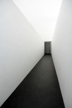 Beautiful black stone floor + clean white walls.