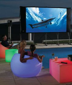 Create a brilliant outdoor scene with light-up Glow Outdoor Furniture, which glows wirelessly.