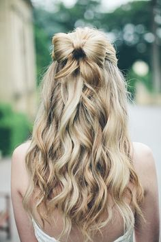 long loose waves and a sweet hair bow for the bride! ~ we ❤ this! moncheribridals.com