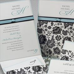 Black and White Floral Wedding Invitation. I would change the floral to damask or lace and the blue to red