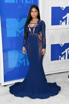 Nicki Minaj at the VMAs 2016 wearing a cobalt blue dress with cut outs and Harry Kotlar diamond earrings and Le Vian diamond ring