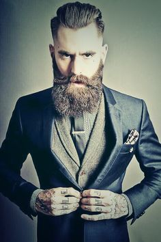Beard, suit and tattoos