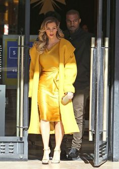 Kim Kardashian wears bright yellow as she gets ready to shop in New York City with Kanye West and mom Kris Jenner on December 11, 2013.