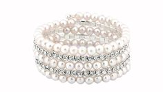 Multi-Row Faux-Pearl and Simulated Crystal Bracelets Dazzle on your evening out with one of these Multi-Row Faux-Pearl and Simulated Crystal Bracelets      Each features rows of clear Swarovski Elements crystals      Also has rows of shiny faux pearls       Features a metal brass base      Bracelet is 17cm around      Full dimensions: 17cm x 5.08cm x 7.62cm      Perfect for special occasions ...