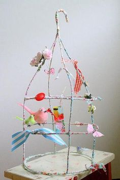 diy bird cage from wire Really adorable! Simply wire covered with vintage ditsy print linens and ribbon. Love the stripes with the ditsy! Fun little birds, flowers and butterflies that can be found at Michaels and Hobby Lobby. Wire Crafts, Diy And Crafts, Crafts For Kids, Arts And Crafts, Diy Projects To Try, Craft Projects, Craft Ideas, Decor Ideas, Diy Bird Cage