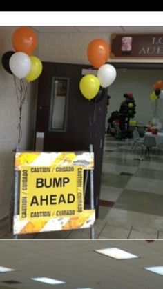 Under construction baby shower...at the entrance. We bought regular colored poster board from Hobby Lobby (2/$1.00) and added the cut out letters and caution tape.