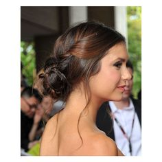 Check Out the Little Move That Made Nina Dobrev's Bun Look All... ❤ liked on Polyvore