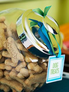 Keep dog treats handy in a clear cookie jar. Print a label on heavy cardstock or matte photo paper and place inside a metal-rimmed tag (available at craft stores, in the scrapbooking department). Slip a pretty ribbon through a punched hole for an extra pop of color. And be sure to keep the jar out of Fido's reach.  Editor's Tip: We used square metal ring tags from Memory Makers