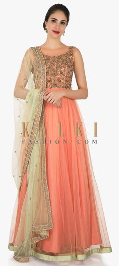 Buy Online from the link below. We ship worldwide (Free Shipping over US$100) Click Anywhere to Tag Peach net anarkali suit heavily embroidered in zardosi and moti work only on Kalki This peach anarkali suit in net jazz up your look effortlessly. This simple yet elegant suit is textured heavily with zardosi and moti embroidered work. The bottom in peach is featured in lycra whereas the net dupatta is enhanced in green color.