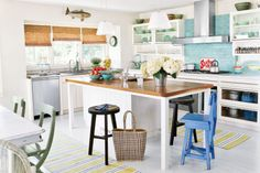 Enhance the natural beauty of your home with sea-themed accents, crisp whites, and splashes of bold color.