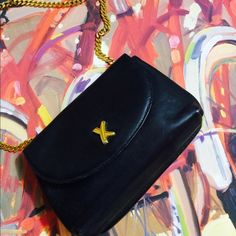 HP DATE NIGHT Pabloma Picasso black leather purse Mint condition NWOT black with Gold chain if your not familiar with this Designer this designer has a line for Tiffany's so if the Symbol on the hardware looks familiar that's why Other Designer Collaborations include Marc Jacobs for Louis Vuitton this purse is a gem & I'm great condition. Pabloma Picasso Bags