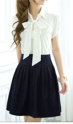 White Short Puff-Sleeved Button-Up Ruffled Top with Large Bow and Navy Blue Pleated Skirt
