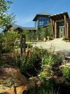 glass-landscape-rock-Exterior-Contemporary-with-boulders-covered-entry-driveway.jpg (740×990)