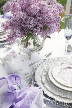 Lilacs And All That Jazz: T his lilac table, set last year, is one of my very favorite StoneGable tablescapes. Tulpen Arrangements, Floral Arrangements, Flower Arrangement, Lilac Wedding, Wedding Flowers, Wedding Dresses, Lavender Cottage, Beautiful Table Settings, Festa Party