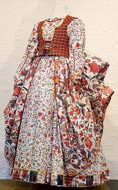 """Dutch dress made from """"sitsen"""", fabrics whose designs were influenced by oriental patterns  from the East (=Java, China, India, Japan) brought back by seafarers of the VOC (Vereenigde Oostindische Compagnie=Dutch East India Company) in the 17th/18th century. Initially the fine cotton fabrics,handprinted in India, were only accessible  to the Dutch elite.Later, towards the end of the eighteenth century cheaper versions, often printed in Europe, were introduced to the market and began to be…"""