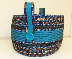 Looking for sewing project inspiration? Check out Large Fabric Coiled Basket in Teal with  by member McGettDM.
