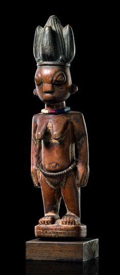 "Africa | Female twin figure ""ere ibeji"" from the Yoruba people of Nigeria | Wood, paint, camwood powder ""osun"",  glass beads | ca. mid 20th century"